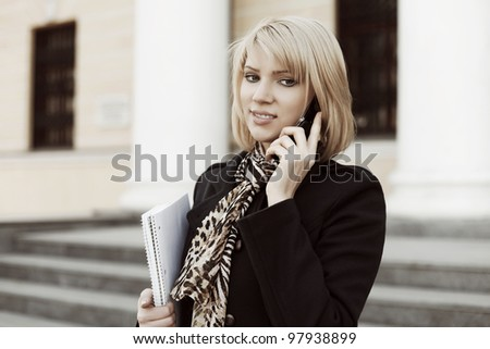 Young businesswoman on the phone - stock photo