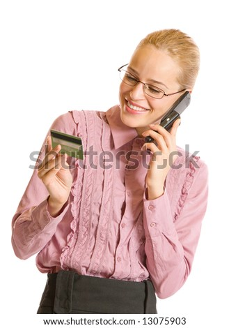 Young businesswoman paying with credit card by cellphone, isolated - stock photo