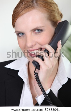 Young businesswoman phoning