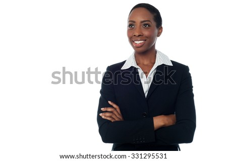 Young businesswoman posing with folded arms