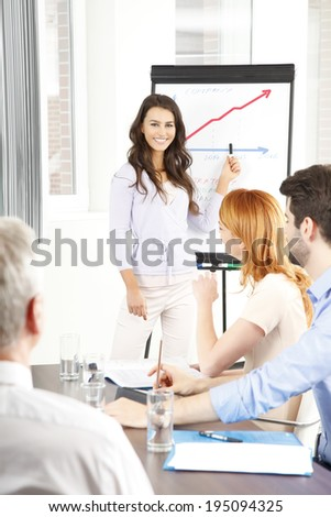 Young businesswoman presenting her ideas to business team. Business meeting.  - stock photo