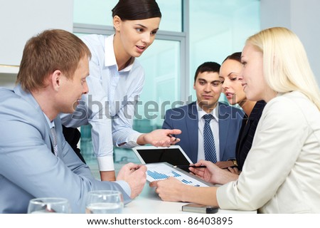 Young businesswoman presenting her work - stock photo
