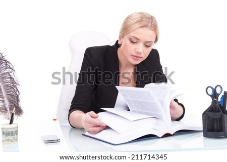 Young businesswoman reading on white background and looking into book. beautiful young woman flipping pages - stock photo