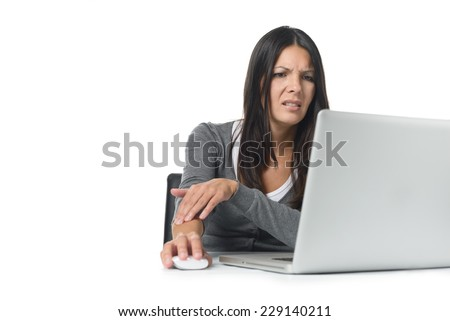 Young businesswoman rubbing and massaging her forearm to relieve cramps after using a computer mouse for too long at a stretch, on white - stock photo