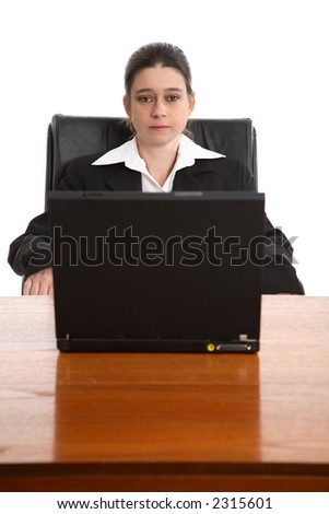 Young businesswoman sat in front of a laptop