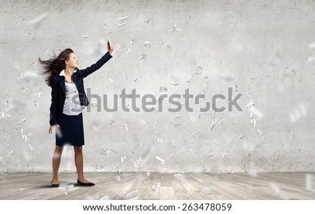 Young businesswoman screaming with rage in mobile phone - stock photo