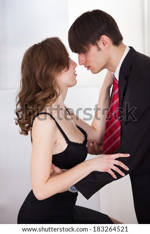 Young businesswoman seducing her boss in the office