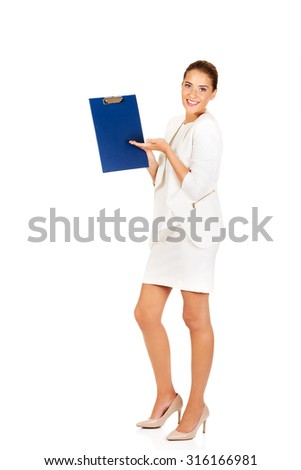 Young businesswoman show empty clipboard.