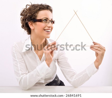Young businesswoman showing a triangle symbol - stock photo