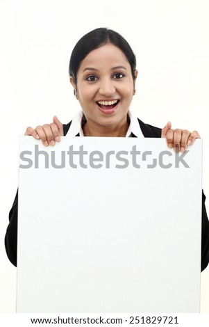Young businesswoman showing blank signboard - stock photo