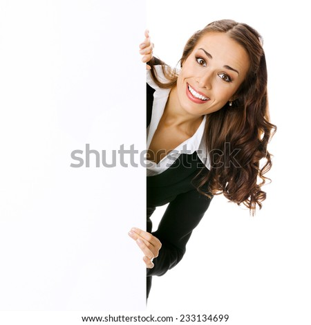 Young businesswoman showing blank signboard with copyspace area, isolated against white background - stock photo