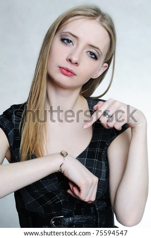 Young businesswoman showing her wrist watch - stock photo