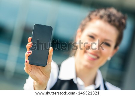 Young Businesswoman Showing Mobile Phone - stock photo
