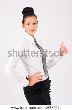 Young businesswoman showing ok gesture (thumb up) at white background - stock photo