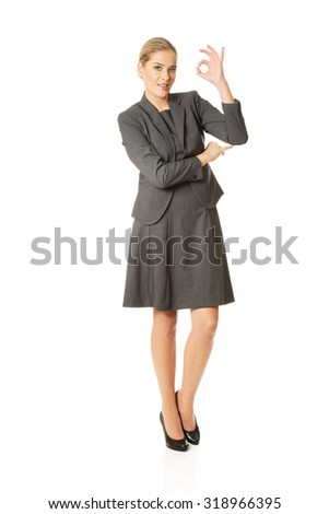 Young businesswoman showing perfect sign - stock photo