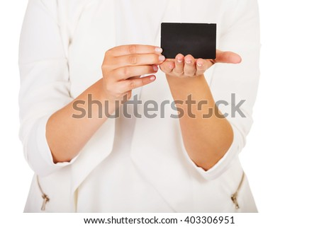 Young businesswoman shows business card - stock photo