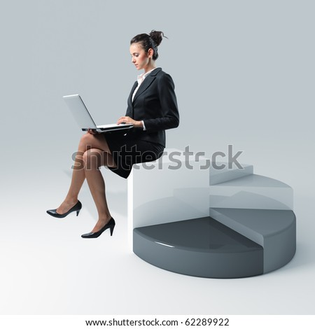 young businesswoman sit on 3d pie chart using laptop - stock photo