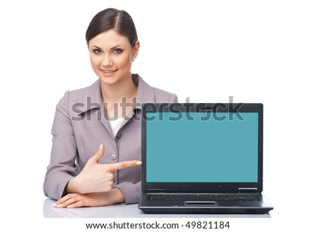 Young businesswoman sitting at the table pointing at the laptop over white - stock photo