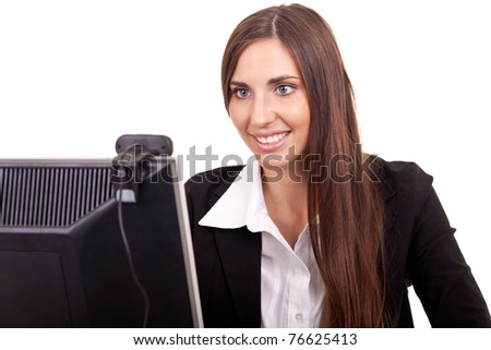 young businesswoman sitting behind computer, online conference - stock photo