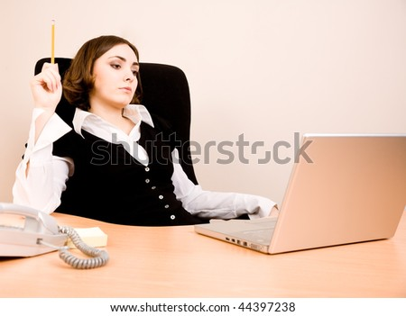 Young businesswoman sitting in the chair and thinking