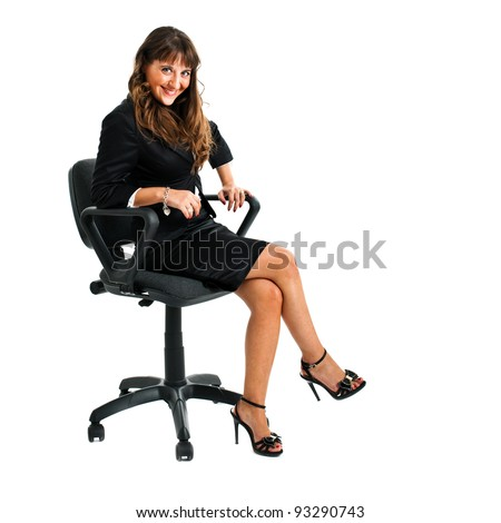Young businesswoman sitting on a chair isolated on white - stock photo