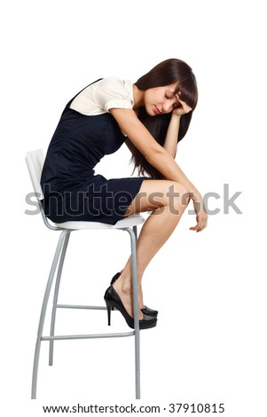 young businesswoman sitting on a tall chair looking exhausted - stock photo