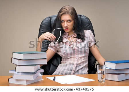 Young businesswoman sitting on chair in office