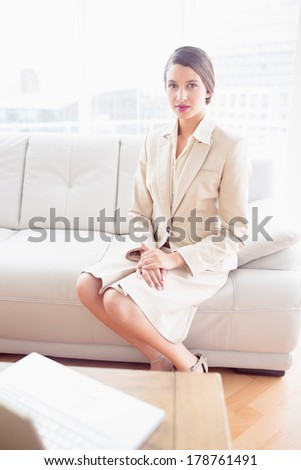 Young businesswoman sitting on sofa in the office