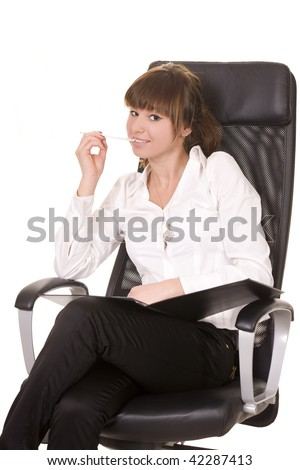 Young businesswoman sitting on the office chair with pen - stock photo