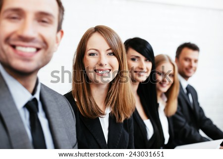 Young businesswoman sitting with business partners. Human resources concept - stock photo