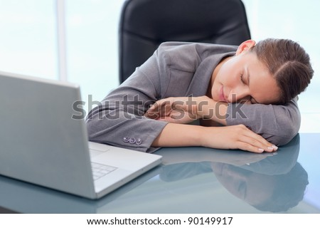 Young businesswoman sleeping in her office