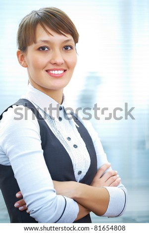 Young businesswoman smiling and looking to camera - stock photo