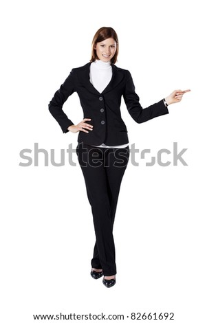 Young businesswoman smiling and pointing to the left - stock photo