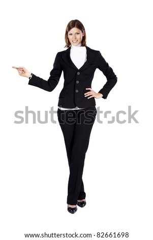 Young businesswoman smiling and pointing to the right