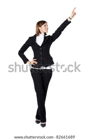 Young businesswoman smiling and pointing up