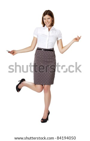 Young businesswoman smiling, dancing and holding phone in her hand - stock photo