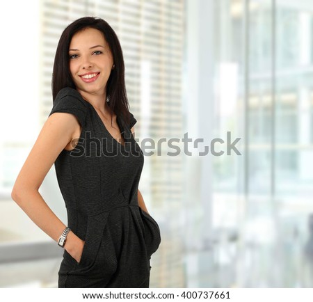 Young businesswoman smiling in the office - stock photo