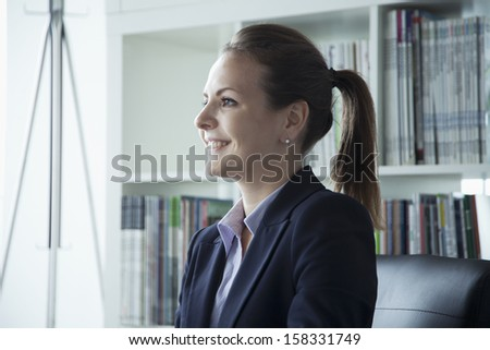 Young businesswoman smiling in the office during a business meeting