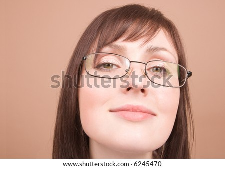 Young businesswoman smiling isolated on beige background - stock photo
