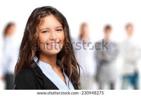 Young businesswoman standing before her team