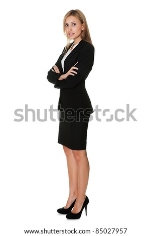 Young businesswoman standing confidently on white - stock photo