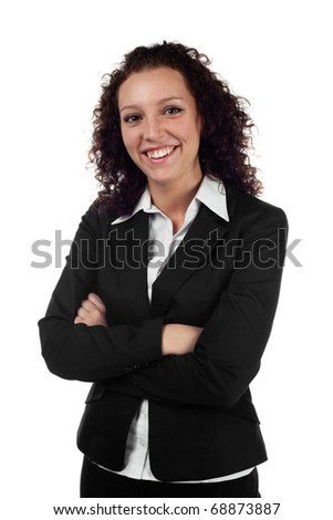Young businesswoman standing with crossed arms against white background