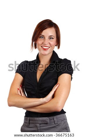 young businesswoman standing with her arms crossed and smiling
