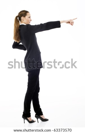 Young businesswoman standing with her hand indicating on white background