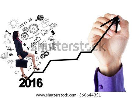 Young businesswoman stepping up on the stair with numbers 2016 and doodle while a hand drawing the stair shaped upward arrow - stock photo