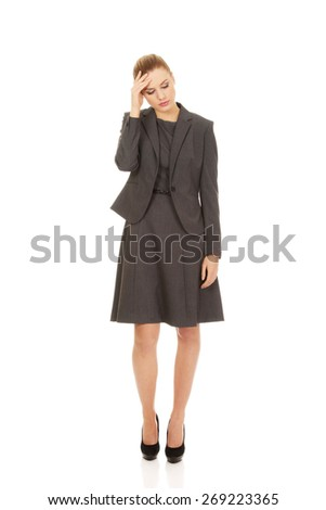 Young businesswoman suffering from headache. - stock photo