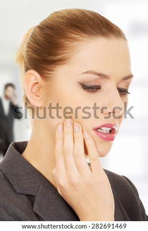 Young businesswoman suffering from tooth ache. - stock photo