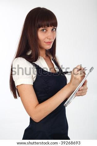young businesswoman taking notes on  a notebook  off white background - stock photo