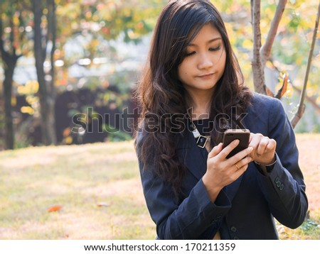 young businesswoman talking on mobile phone - stock photo