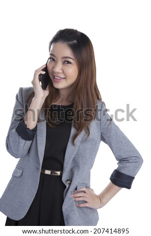 Young businesswoman talking on mobile phone. Beautiful young multiracial Chinese Asian / caucasian xwoman talking on her cellphone. Isolated on white background.